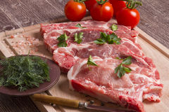 Fresh raw pork chop meat on cutting board Stock Photography