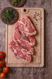 Fresh raw pork chop meat on cutting board Stock Photos