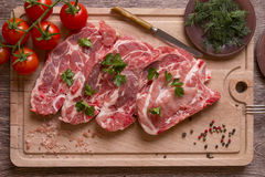 Fresh raw pork chop meat on cutting board Royalty Free Stock Photo