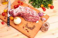 Fresh Raw Pork Chop. With tomatoes, greens and spices Stock Photography