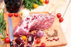 Fresh Raw Pork Chop. With tomatoes, greens, spices and garnet Stock Photos