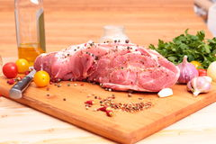 Fresh Raw Pork Chop. With tomatoes, greens, spices and garnet Stock Photography