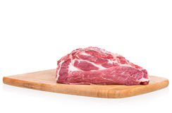 Fresh raw pork. On the chopping board  on a white background Royalty Free Stock Image
