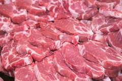 Fresh raw pork chops at butcher shop. Background Stock Photo