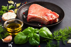Fresh raw pork chops with spices and herbs Royalty Free Stock Photography