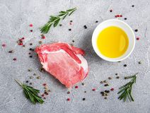 Fresh raw pork chops with spices and herbs. On a stone background Stock Images