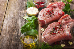 Fresh raw pork chops with spices and herbs Royalty Free Stock Photos