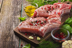 Fresh raw pork chops with spices and herbs Stock Image
