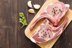 Fresh Raw Pork Chops on wooden background. Royalty Free Stock Photo