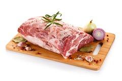 Fresh raw pork on cutting board. On white background Stock Photo