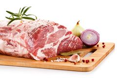 Fresh raw pork on cutting board. On white background Stock Images