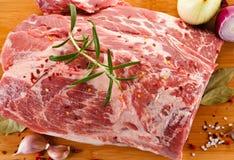 Fresh raw pork on cutting board. On white background Stock Photos