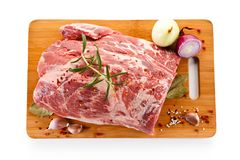 Fresh raw pork on cutting board. On white background Stock Photography
