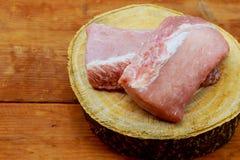 Fresh raw pork on cutting board. Pieces of pork on a cutting board Stock Image