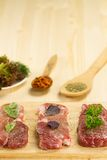 Fresh raw pork on cutting Board with spices Royalty Free Stock Photography
