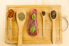 fresh raw pork on cutting Board with spices Royalty Free Stock Image