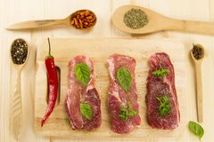 Fresh raw pork on cutting Board with spices Royalty Free Stock Photo