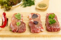 fresh raw pork on cutting Board with spices Stock Photos
