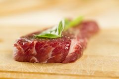 Fresh raw pork on cutting Board with spices and herbs. Royalty Free Stock Photography