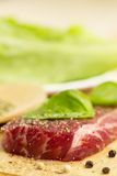 Fresh raw pork on cutting Board with spices and herbs. Royalty Free Stock Photo
