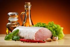 Fresh raw pork on cutting board. Fresh raw pork and vegetables on cutting board Stock Image