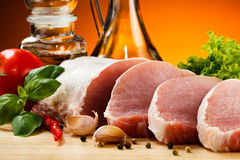 Fresh raw pork on cutting board Stock Images