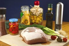 Fresh raw pork on a cutting board with vegetables Royalty Free Stock Image