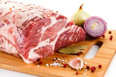 Fresh raw pork on cutting board. On white background Royalty Free Stock Photography