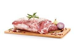 Fresh raw pork on cutting board. On white background Royalty Free Stock Image