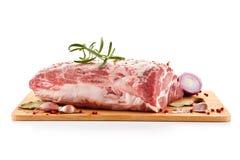 Fresh raw pork on cutting board. On white background Royalty Free Stock Photo