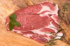 Fresh raw pork. On a wooden mango board Royalty Free Stock Photos