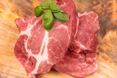 Fresh raw pork. On a wooden mango board royalty free stock images