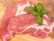 Fresh raw pork. On a wooden mango board royalty free stock image