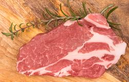 Fresh raw pork. On a wooden mango board stock images