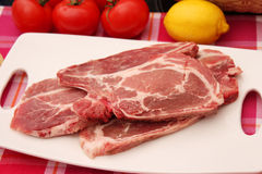 Fresh raw pork. On a kitchen board Royalty Free Stock Photo