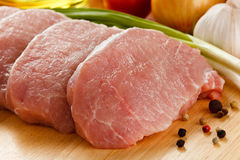 Fresh raw pork loin. On wooden background Royalty Free Stock Image