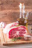 Fresh raw pork meat chops. On   cutting board on old wooden background Stock Photography