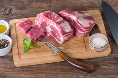 Fresh raw pork meat chops Royalty Free Stock Photos