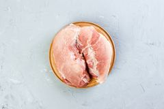 Fresh Raw pork meat on grey background. Top view.  Royalty Free Stock Photography
