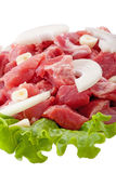 Fresh raw pork meat and salad isolated on white. Background Royalty Free Stock Photography