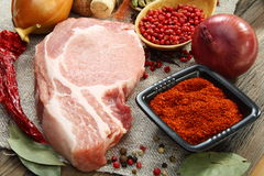 Fresh raw pork meat and spices. Fresh raw pork meat and spices on an old wooden table Stock Photos