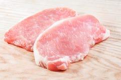 Fresh raw pork meat on wooden cutting board Stock Photo