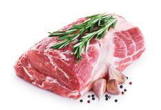 Fresh raw pork neck meat, garlic, pepper and rosemary. Isolated on white background Royalty Free Stock Photos