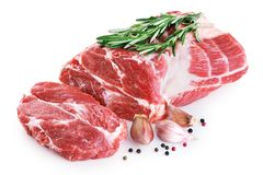 Fresh raw pork neck meat, garlic, pepper and rosemary. Isolated on white background stock photo