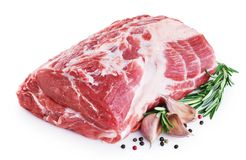 Fresh raw pork neck meat, garlic, pepper and rosemary isolated on white background. With clipping path Royalty Free Stock Photo