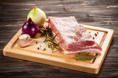 Fresh raw pork. Fresh raw rib on cutting board Royalty Free Stock Photos