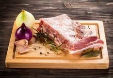 Fresh raw pork. Fresh raw rib on cutting board Royalty Free Stock Images