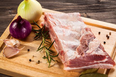 Fresh raw pork. Fresh raw rib on cutting board Royalty Free Stock Photography