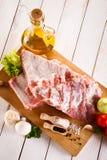 Fresh raw pork. Fresh raw rib on cutting board Royalty Free Stock Photo