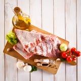 Fresh raw pork. Fresh raw rib on cutting board Stock Photos